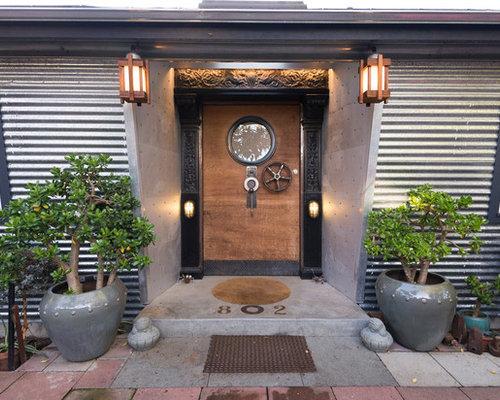 Eclectic entryway photo in San Francisco with a medium wood front door & Steampunk Door   Houzz pezcame.com