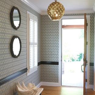 Entryway - contemporary medium tone wood floor entryway idea in Raleigh with multicolored walls
