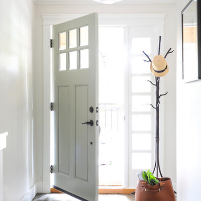 Small transitional slate floor entryway photo in Vancouver with white walls