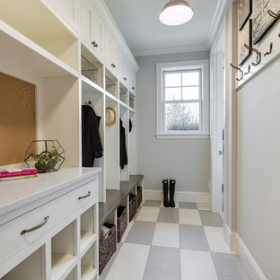 Example of a classic mudroom design in Minneapolis with gray walls