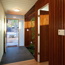 Midcentury Entry by Klopf Architecture