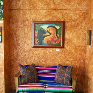 Example of a southwest entryway design in Austin with orange walls