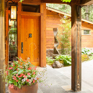 Inspiration for a mid-sized rustic entryway remodel in Seattle with a dark wood front door