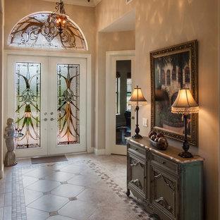 Exemple d'un hall d'entrée chic avec un sol en carrelage de porcelaine, une porte double, un mur beige et une porte en verre.