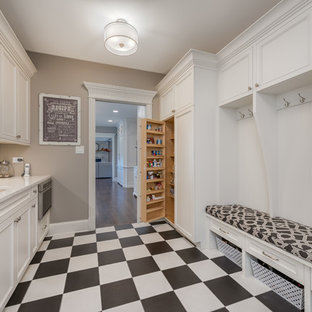 Mid-sized cottage porcelain floor and multicolored floor mudroom photo in Chicago with gray walls