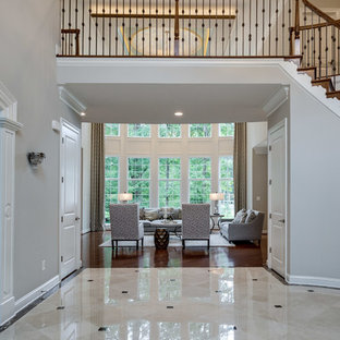 Transitional marble floor and beige floor foyer photo in DC Metro with gray walls