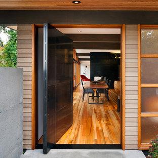 Entryway - mid-century modern entryway idea in Seattle with a black front door