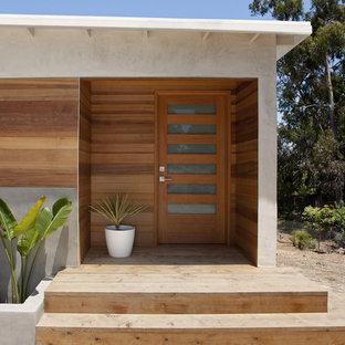 Entryway - modern entryway idea in San Diego with a medium wood front door