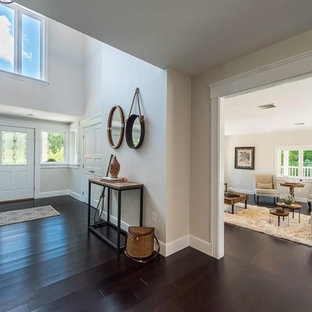 Example of a large transitional bamboo floor and brown floor double front door design in Boston with gray walls and a white front door
