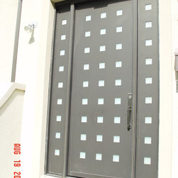 Entrance Doors by Arttig - 6 f. x 8 f. powder coated in antique Bronze color.