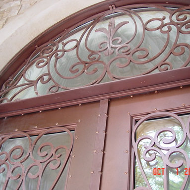 Entrance Doors by Arttig - 6 f. x 11 f. powder coated in Copper vain color.