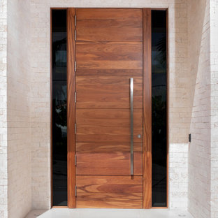 Example of a minimalist porcelain tile, white floor, wood ceiling and brick wall entryway design in Miami with beige walls and a medium wood front door
