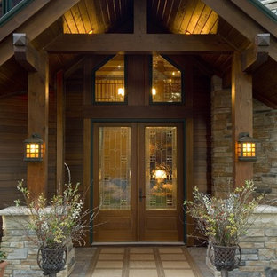 Mountain style entryway photo in Minneapolis with a glass front door