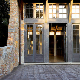 Example of a mountain style double front door design in Chicago