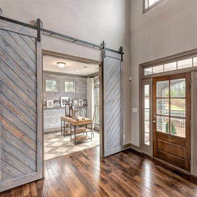 Entryway - large country dark wood floor entryway idea in Atlanta with beige walls and a medium wood front door