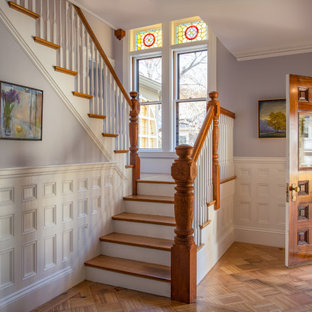 Inspiration for a timeless medium tone wood floor and brown floor entryway remodel in Boston with purple walls and a medium wood front door