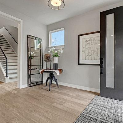 Entryway - large cottage medium tone wood floor entryway idea in Seattle