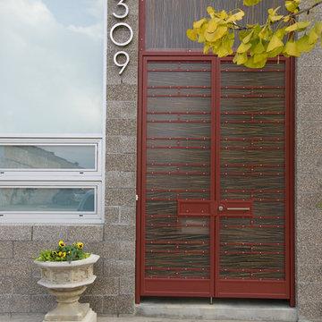 entry detail - decorative unit masonry, resin panels and custom ironwork
