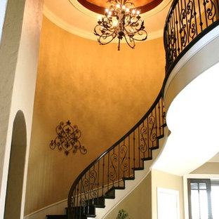 Example of a large classic foyer design in Other with beige walls