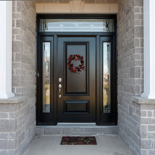 Inspiration for a mid-sized timeless entryway remodel in Toronto with a black front door