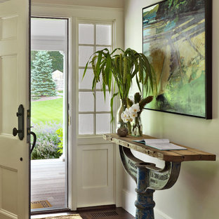 Cottage entryway photo in Boston with beige walls and a white front door