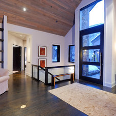 rustic entry by Forum Phi - Architecture | Interiors | Planning