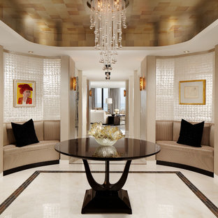 Example of a trendy foyer design in Miami with beige walls