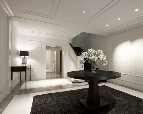 Contemporary Foyer Idea In Chicago With White Walls And Marble Floors