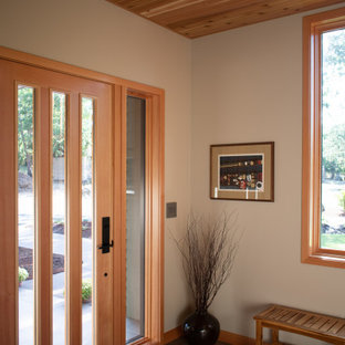 Example of a mid-sized trendy porcelain tile, brown floor and wood ceiling entryway design in Other with a light wood front door
