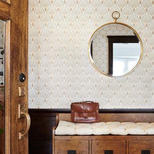 Entryway - transitional medium tone wood floor entryway idea in San Francisco with multicolored walls and a dark wood front door