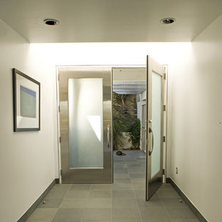 Entry hall to contemporary home by MGS architecture