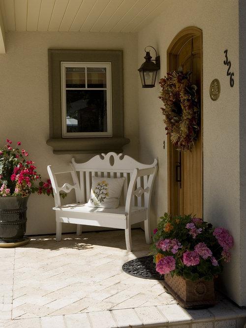 elegant entryway photo in san francisco with a medium wood front door