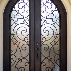 Traditional Front Doors by San Marcos Iron Doors