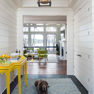 Example of a coastal entryway design in Minneapolis with white walls
