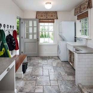 Entryway - traditional entryway idea in Portland with white walls and a glass front door