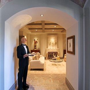 Foto de distribuidor clásico renovado, grande, con paredes blancas, suelo de ladrillo, puerta doble y puerta de vidrio