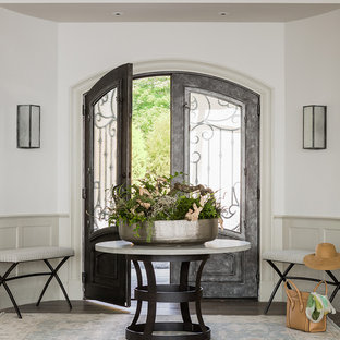 Example of a coastal dark wood floor double front door design in Boston with white walls and a glass front door