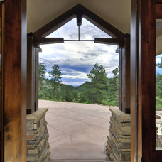 Rustic Entry by Aneka Interiors Inc.