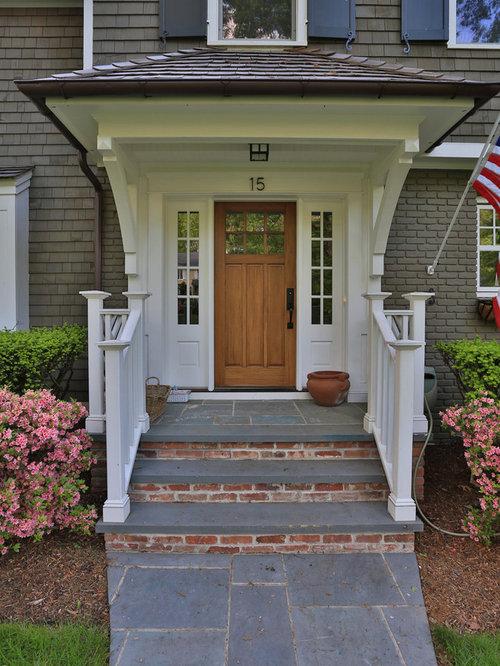 Traditional entryway idea in New York with a medium wood front door & Front Door Portico | Houzz pezcame.com