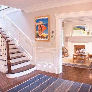 Imagen de distribuidor clásico renovado, de tamaño medio, con paredes grises, suelo de madera en tonos medios y puerta simple