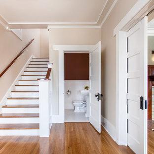 Entryway - mid-sized craftsman medium tone wood floor entryway idea in Santa Barbara with beige walls and a medium wood front door