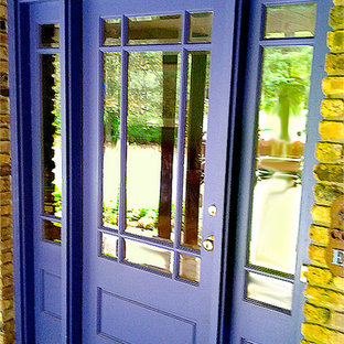 Example of a mid-sized transitional entryway design in Chicago with a purple front door