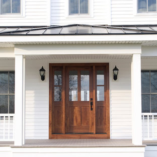 Entryway - large country entryway idea in Other with white walls and a dark wood front door
