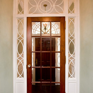 Example of a small classic dark wood floor entryway design in Boston with white walls and a dark wood front door