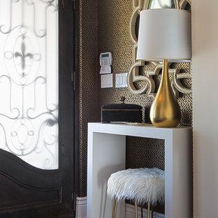 Mid-sized cottage chic dark wood floor and brown floor front door photo in Other with metallic walls and a glass front door