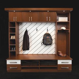 Mudroom - small contemporary mudroom idea in Other with black walls