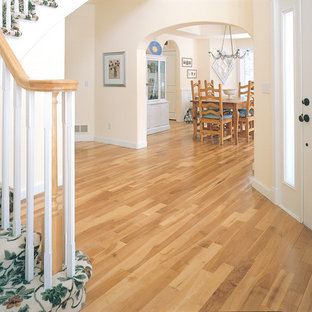 Inspiration for a small timeless beige floor and medium tone wood floor entryway remodel in Denver with beige walls and a white front door