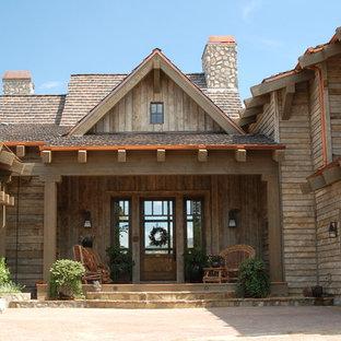 Entryway - huge traditional travertine floor entryway idea in Phoenix with beige walls and a glass front door