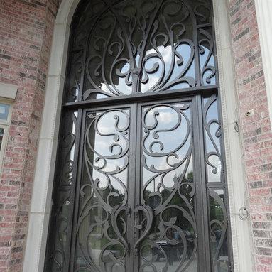 EntV top Entrance Doors by Arttig - 8 f. x 18 f. powder coated in bronze vain color.