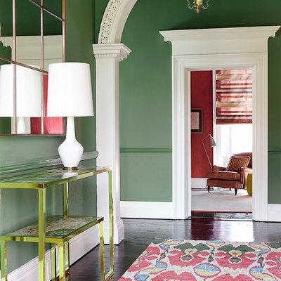 Foyer - transitional dark wood floor foyer idea in Dublin with green walls